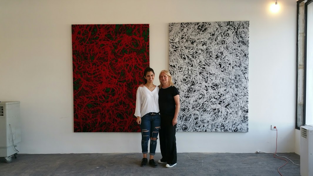 me and my assistant Ghida in front of my Omniverse tapestries